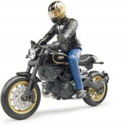 Motociklas Scrambler Ducati Cafe Racer su vairuotoju